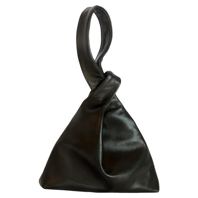 A refined black leather handbag. An unusual deign, one wrist strap threads through a small loop to form the bag closure.