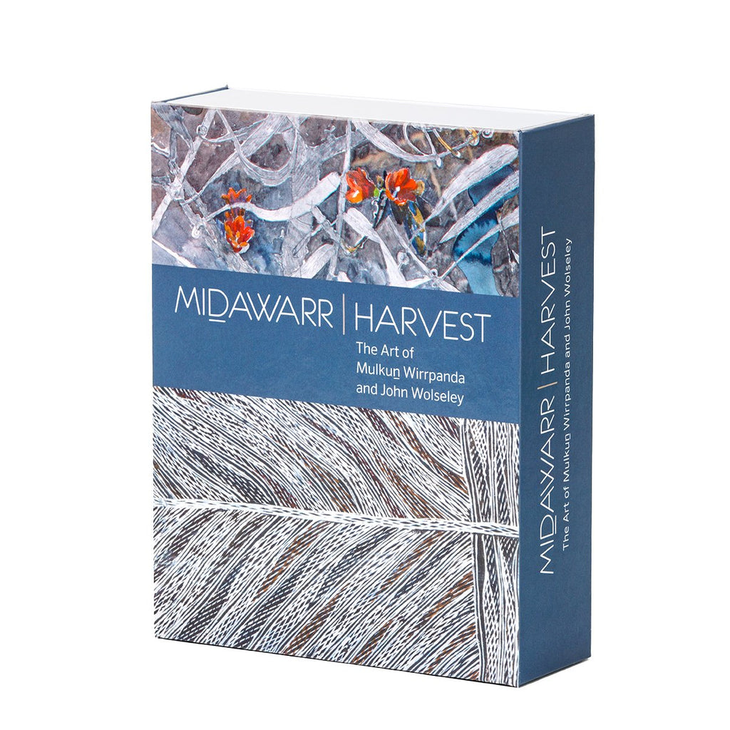 Image featuring a card pack packing box which includes two different artworks and a navy grey band with the text saying: Midawarr Harvest: The Art of Mulkun Wirrapanda and John Wolseley