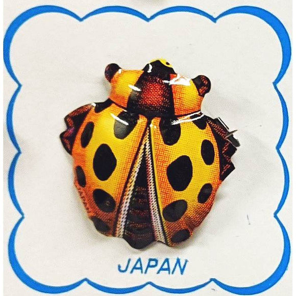 A range of brightly coloured, highly detailed Insect brooches - including a ladybug, cicada and a beetle-shown on cardboard backing.