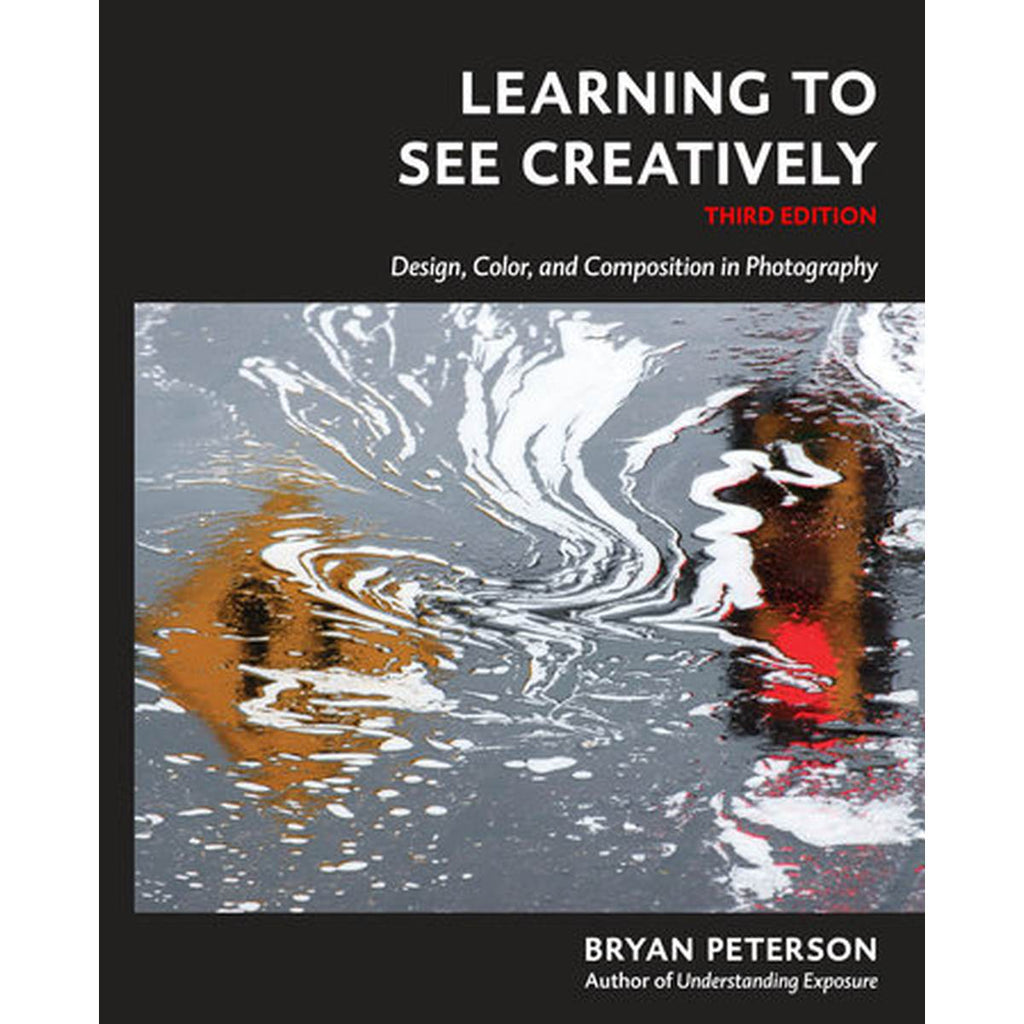 A book cover with a cover photograph of wet bitumen, reflecting the image of traffic lights.