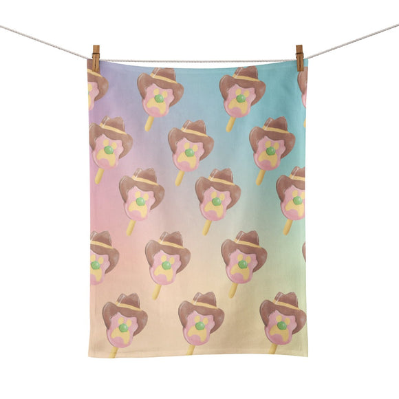 Image featuring a tea towel hung in the center which includes a repeated Bubble O'Bill icecream print on the front