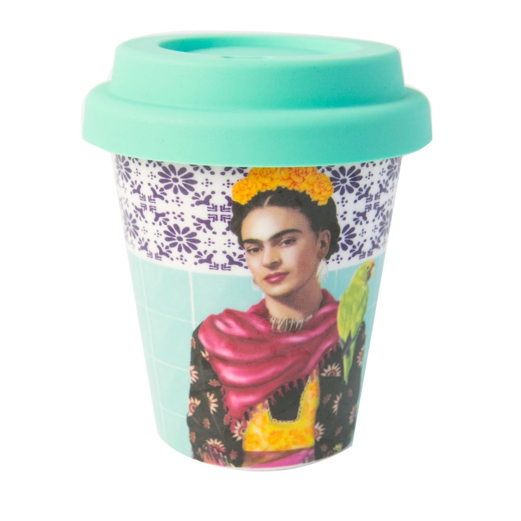 Teal Ceramic Coffee cup with a printed image of an illustration of the Mexican painter Frida Kahlo wearing a floral dress, red scarf with yellow flowers in her hair and a parrot on her shoulder