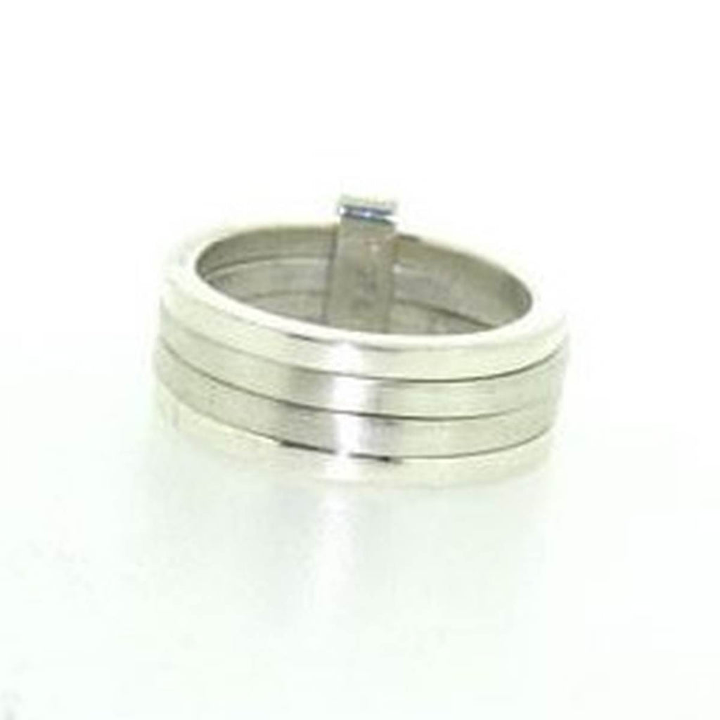 A Silver Ring, featuring four connected bands. 2 highly polished and 2 given a brushed Matte treatment.