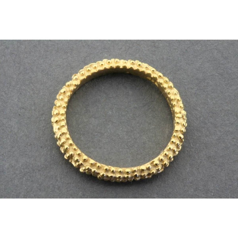 A refined gold plated Sterling Silver band with a 'bubbly' surface texture