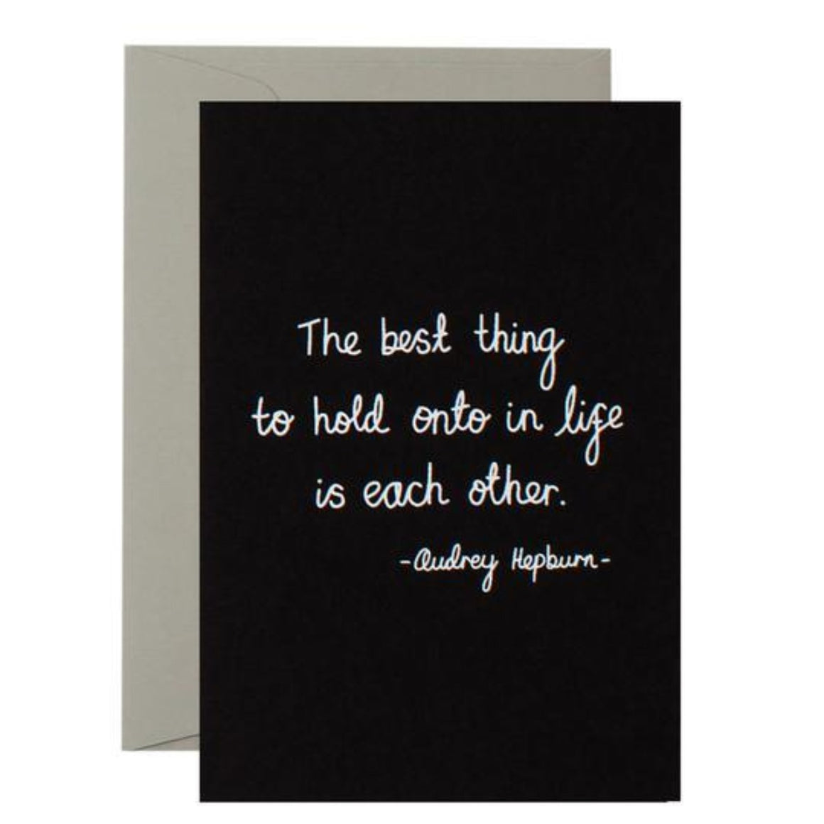 Black Greeting Card with white text saying the best thing to hold onto in life is each other. - Audrey Hepburn