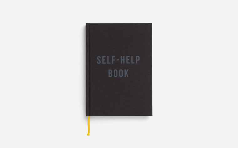 The School of Life Black Notebook featuring the words Self Help Book