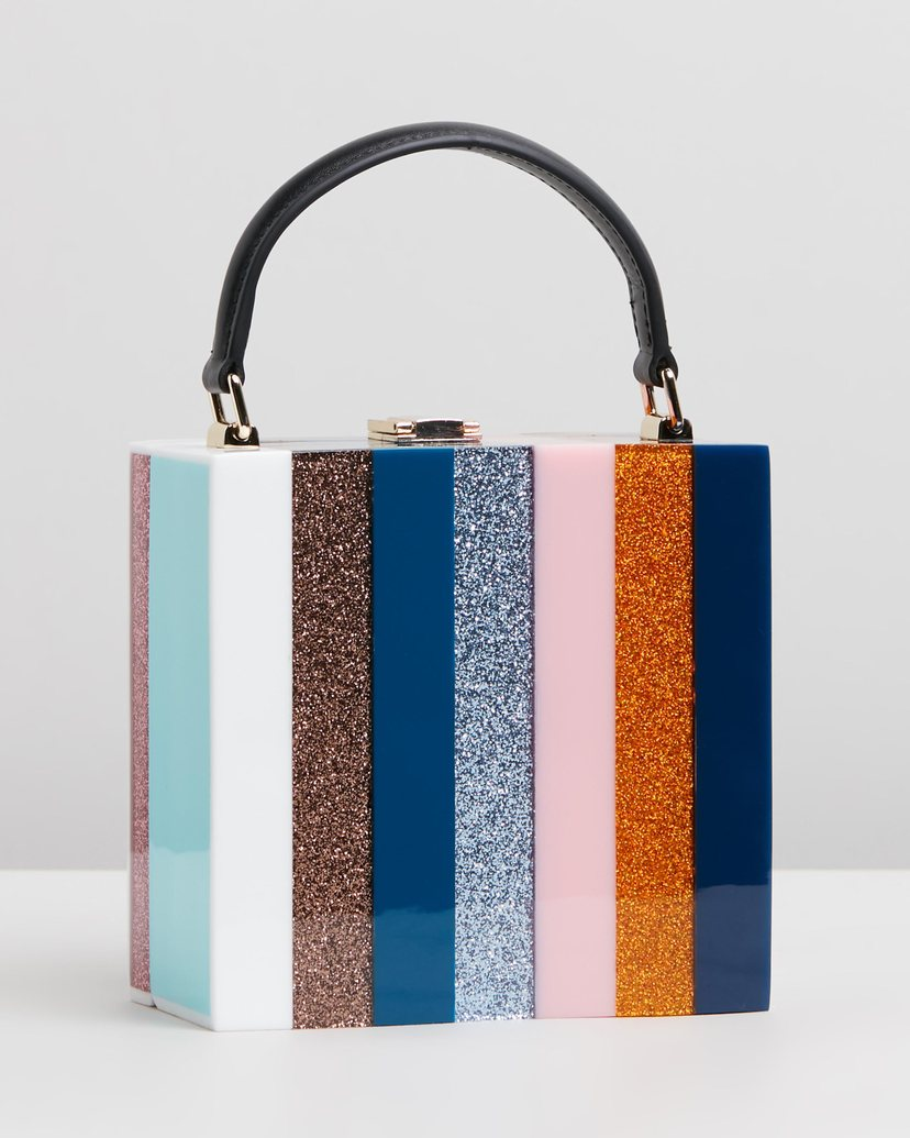 Bag with leather handle made out of resin featuring multi stripe colours