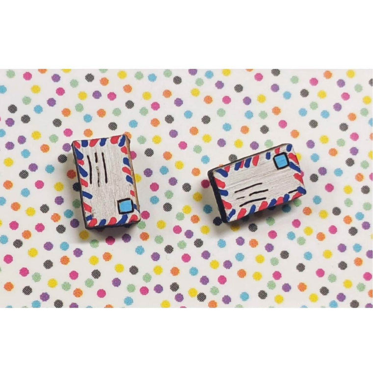 A pair of intricately hand coloured studs depicting two traditional style envelopes. The envelopes feature red and blue stripes on the edges, blue stamps and scrawled writing.