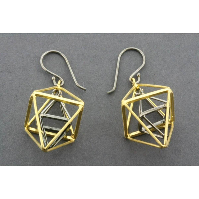 A sterling silver and gold pair of drop earrings each consisting of a double pyramid suspended within another double pyramid