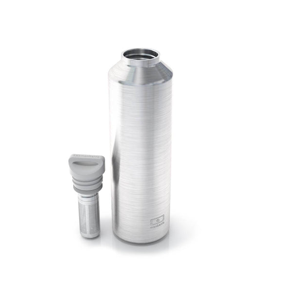 A Monbento Insulated Water bottle composed of brushed Stainless steel and a white lid.