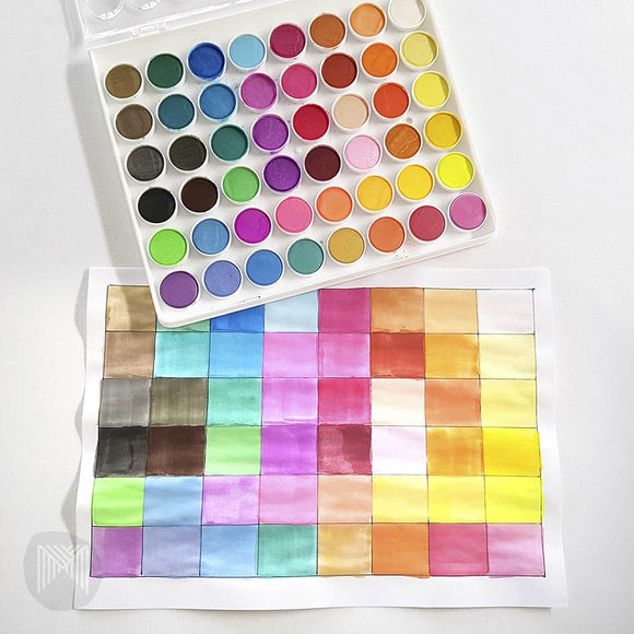 A tray of 48 rich and transparent watercolour paint discs contained in a rectangular pallette. Among the colour ranges are bright, neon and metallic paints. A Brush is included in the set.