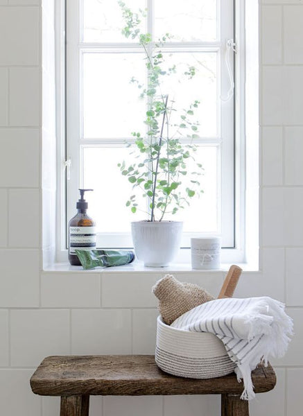 Cotton & Clay - Bench with woven basket and towel in bathroom