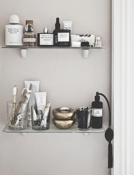 Cotton & Clay - Pretty glass containers in bathroom