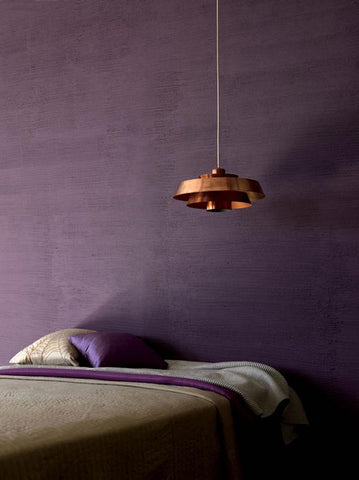 Bedroom with ultra violet wall