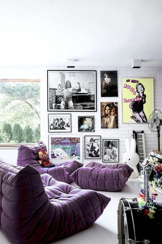 Black and white lounge with ultra violet couches