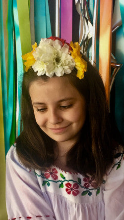 Child wearing fiesta flower crown