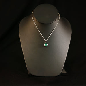 Small Emerald Pendant On Necklace
