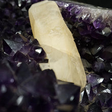 Close Up Of Dog Tooth Calcite Growth On Amethyst