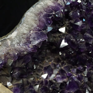 Close Up Of Druzy Crystals Within Amethyst Table Base