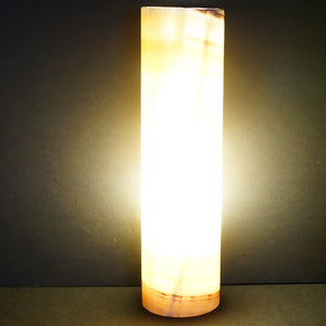 Image Of Lighted Carved Onyx Table Lamp In A Dark Space