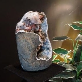 Side View Of Heulandite With Silbite And Calcite Specimen On A Stand