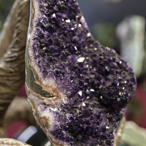 Close Up Amethyst Druzy On Carved Sculpture