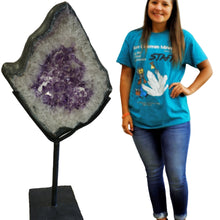 Amethyst Slice On Black Metal Rotating Frame And 5 Foot Tall Female