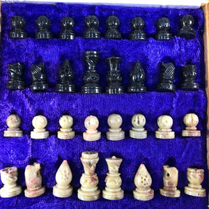 close up carved soapstone chess pieces
