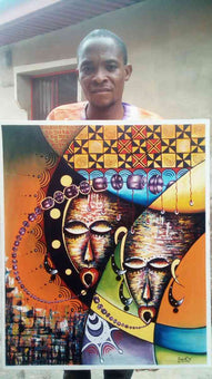 Nigerian African Artist, Femi, with one of his now sold paintings.