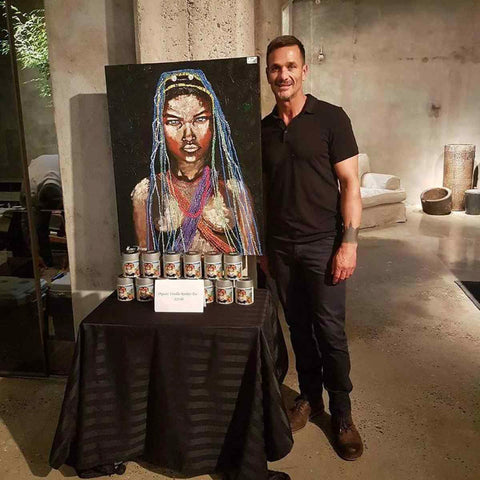 Kowie Theron with one of his sold artworks.