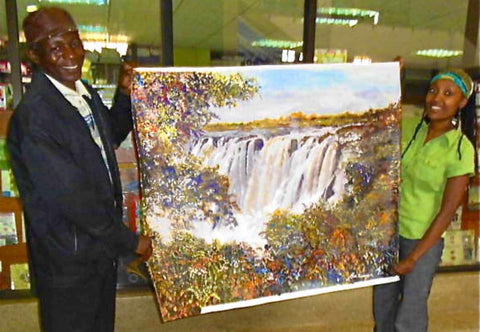 Gathinja Yamokoski with Kenyan Artist, Martin Bulinya, and his painting, Waterfall.