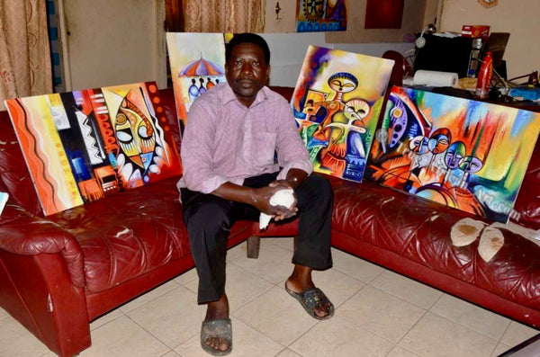 Olumide with the African paintings he made for sale on our website