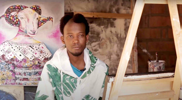 African Artist Seleman Kubwimana from Rwanda with one his paintings