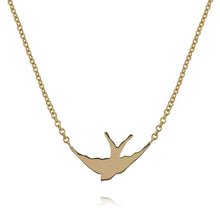 solid gold swallow silhouette necklace on gold chain by louise wade london