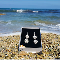 Handmade cypriot filigree jewelry in a box at the beach