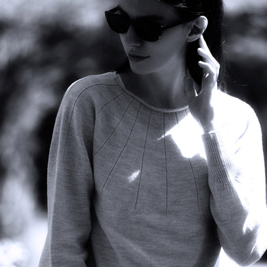 Pale grey round neck sweater knitted in Leicestershire using 100% superfine merino wool