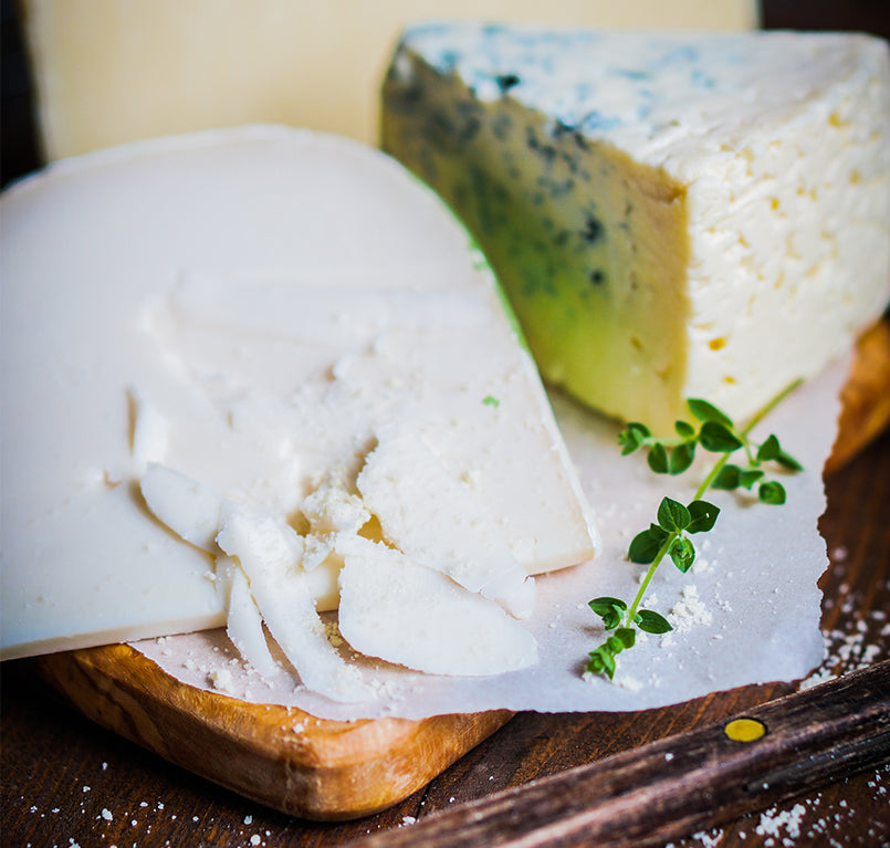 Assorted-Cheese-On-Wooden-Background