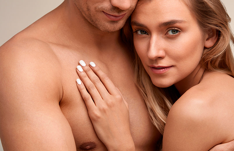 Closeup-Of-Beautiful-Female-Model-Touching-Handsome-Male-Chest