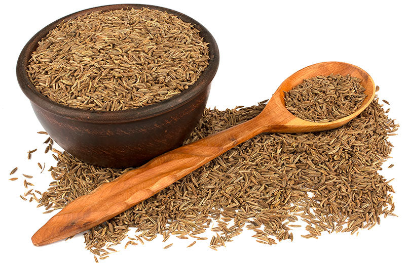 Cumin-seeds-into-a-bowl-and-seeds-in-a-wooden-spoon-isolated-in-white-background
