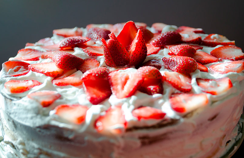 Delicious-hand-made-layered-strawberry-birthday-cake-on-a-dark-grey-background