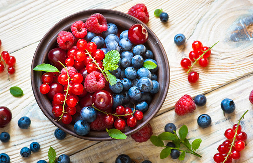 Fresh-berries-in-a-bowl-on-rustic-wooden-table