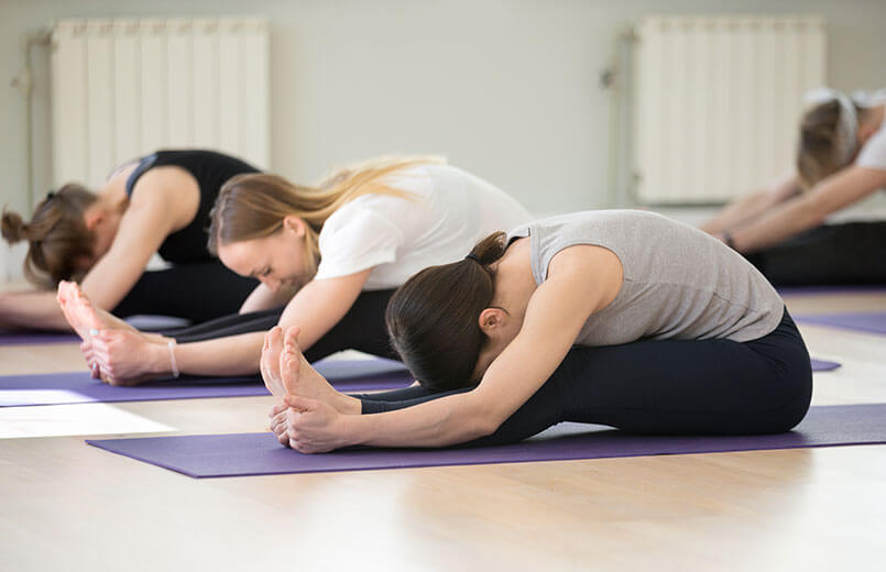 Group-of-people-in-paschimottanasana-pose