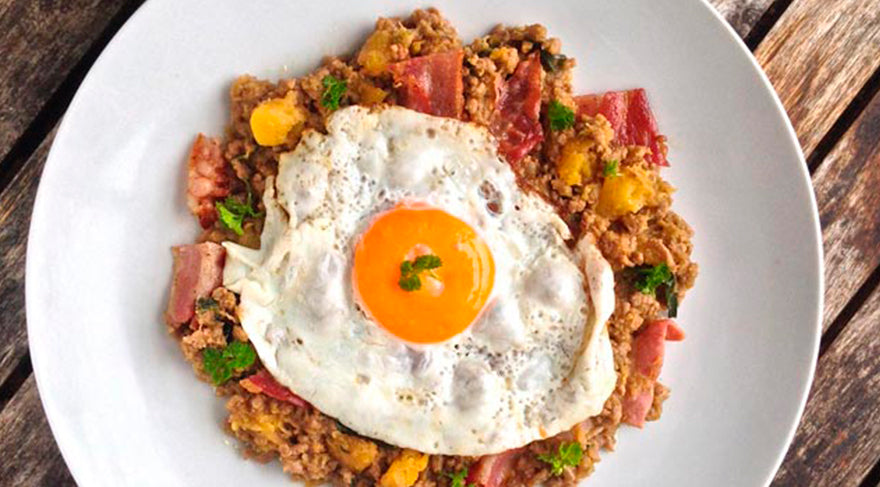 Keto-Pumpkin-&-Beef-Sautée-with-sunny-side-up-egg-over-on-a-white-plate