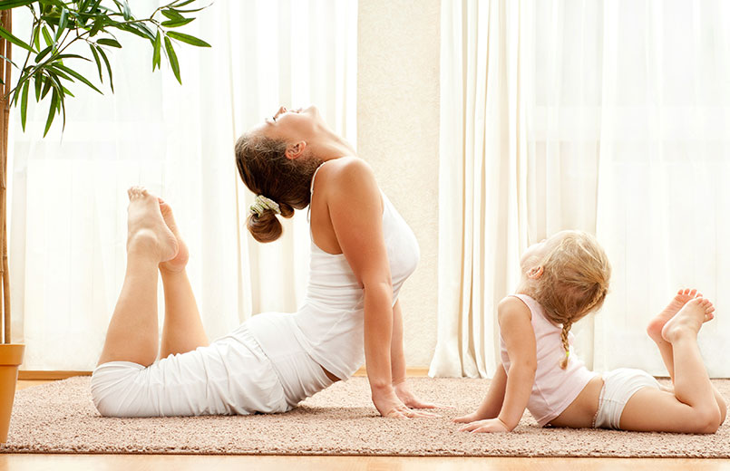 Mother-and-daughter-doing-exercise-at-home