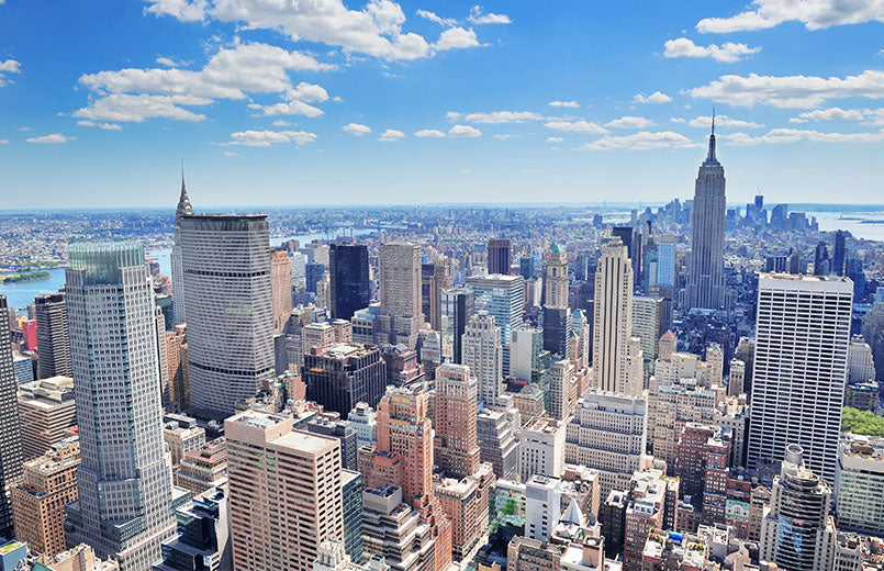 New-York-City-Manhattan-midtown-aerial-panorama-view-with-skyscrapers-and-blue-sky-in-the-day