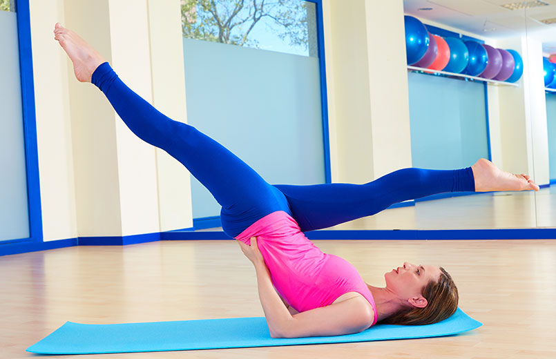 Pilates-woman-scissor-exercise-workout-at-gym-indoor