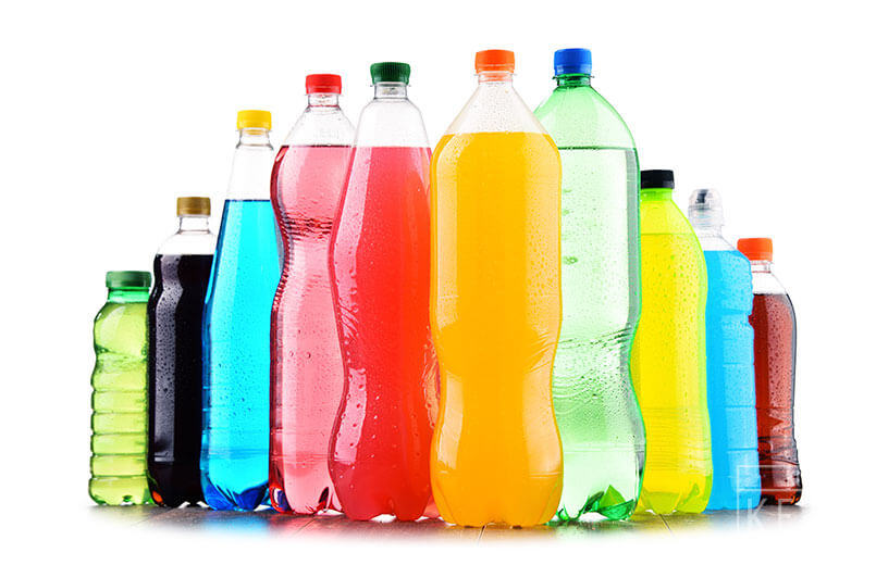 Plastic-bottles-of-assorted-carbonated-soft-drinks-over-white-background
