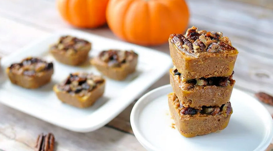 Pumpkin-Pie-Bites-on-wooden-table-with-pumpkin-on-the-background