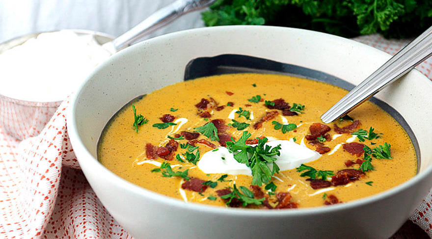 Pumpkin-soup-in-a-white-bowl