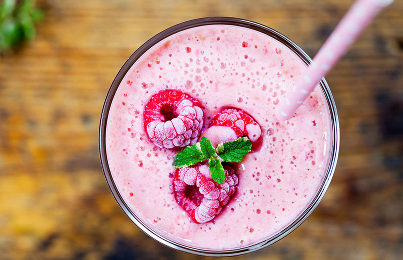 Raspberry Smoothie With Frozen Raspberries On Top